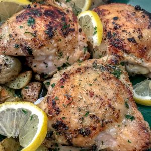 One Pan Lemon Garlic Butter Chicken and Potatoes - this dish is not only incredibly easy to make, but it is also bursting with zingy lemon garlic flavor! Chicken that is crispy on the outside, yet tender and juicy on the inside. Cooked in one pan, making for easy cooking and clean up. #onepanmeals #onepan #chicken | https://withpeanutbutterontop.com