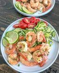 Garlic Honey Lime Shrimp and Zoodles - the perfect low-carb, high-protein recipe that comes together in 15 minutes. Sweet, sticky, garlic lime cooked shrimp and zucchini noodles are the ultimate easy and healthy combination.#shrimp #zoodles #zucchininoodles #lowcarb #healthy   https://withpeanutbutterontop.com