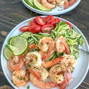 Garlic Honey Lime Shrimp and Zoodles - the perfect low-carb, high-protein recipe that comes together in 15 minutes. Sweet, sticky, garlic lime cooked shrimp and zucchini noodles are the ultimate easy and healthy combination.#shrimp #zoodles #zucchininoodles #lowcarb #healthy | https://withpeanutbutterontop.com