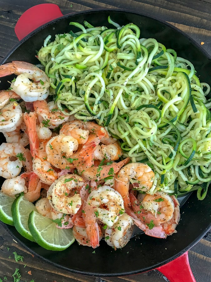Garlic Honey Lime Shrimp and Zoodles - the perfect low-carb, high-protein recipe that comes together in one pan in just 20 minutes. Sweet, sticky, garlic lime cooked shrimp and zucchini noodles are the ultimate easy and healthy combination.