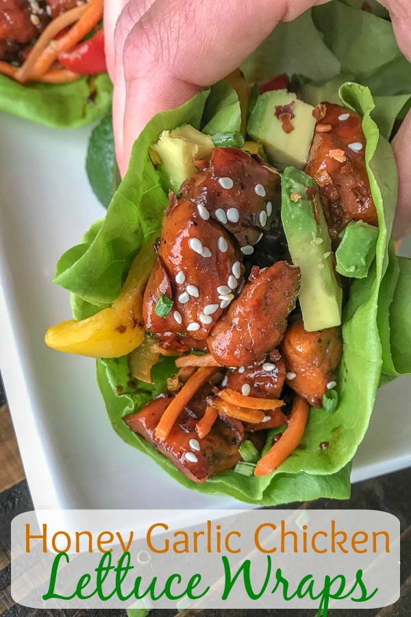 Honey Garlic Chicken Lettuce Wraps - low carb, sweet and savory, and full of flavor. #honeygarlicchicken #lowcarb #healthy #lettucewrap   https://withpeanutbutterontop.com