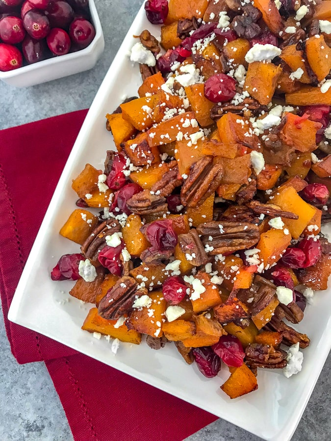Honey Roasted Butternut Squash - a side dish that comes together so easily and with an abundance of flavor! Your taste buds will be tickled pink with this dish! Easy to make and perfect for the holiday season. #butternutsquash #thanksgiving #sidedish | https://withpeanutbutterontop.com