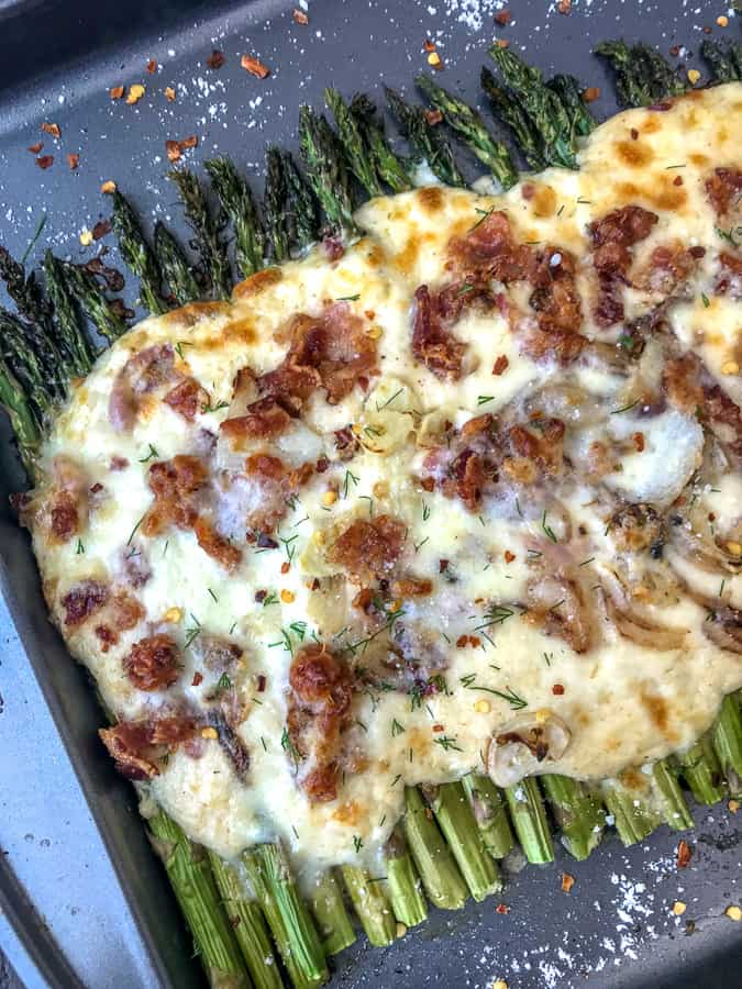 Garlic Roasted Asparagus and Bacon Gratin - the ultimate au gratin vegetable dish you will ever try! Oven-roasted asparagus topped with garlic, shallots, and the creamiest three-cheese sauce! Perfect side dish to any meal and for any occasion! #asparagus #augratin #sidedish | https://withpeanutbutteronto.com