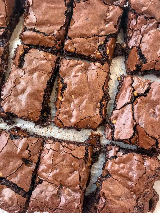 Triple Chocolate Walnut Fudge Brownies | soft, chewy, gooey centers with a crispy, crackle topping! The best brownies you will ever try! Filled with chocolate and finely chopped walnuts. Sure to become a repeat dessert in your home. #brownies #chocolate #triplechocolate | https://withpeanutbutterontop.com