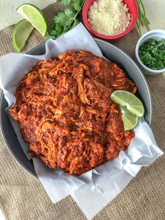 Chicken Tinga made with shredded chicken, tomato sauce, fire roasted tomatoes, and chipotle chilis in adobo. Comes together in 30 minutes, is full of bold flavor, and is great in lettuce wraps and as a #MealPrep lunch! #chickentinga #chicken #easyrecipes #healthy #lunch #dinner | https://withpeanutbutterontop.com