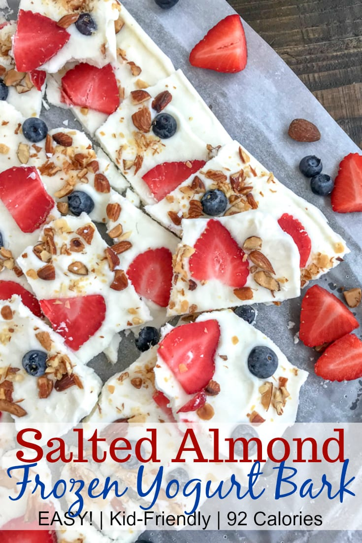 Salted Almond Frozen Yogurt Bark with Berries is the best and easiest healthy snack to help you curb your cravings! Made with a handful of ingredients, simple to make, and guaranteed to be kid-friendly! #yogurtbark #froyo #frozenyogurt #healthysnacks | https://withpeanutbutterontop.com