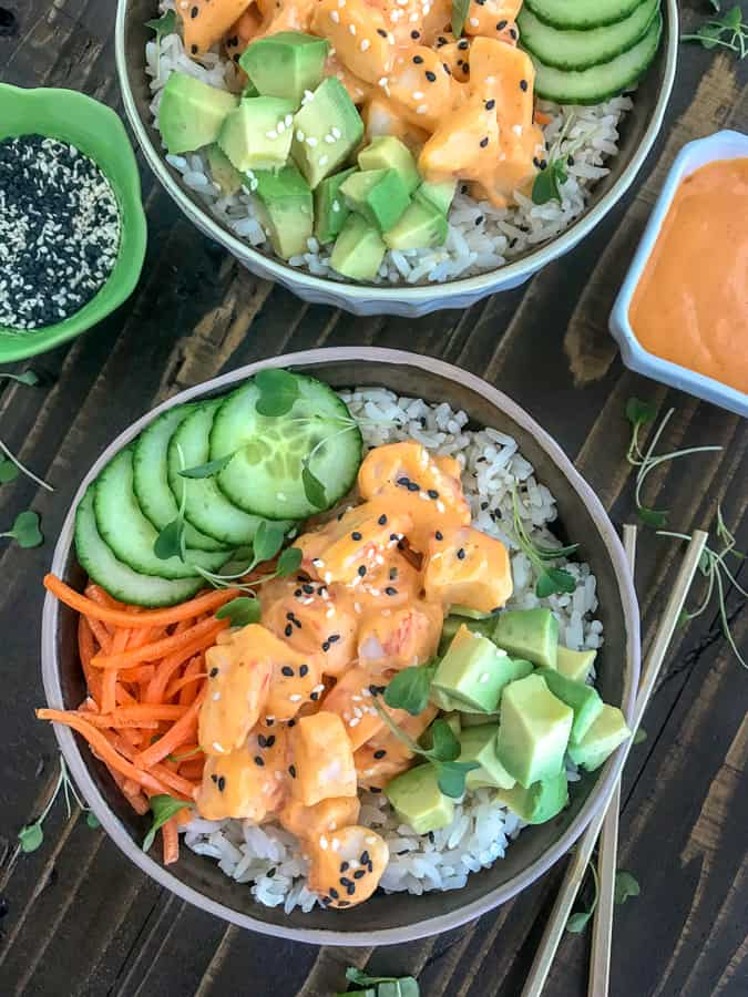 Learn how to make your favorite sushi roll at home - quickly and easily! You only need to cook the rice! Super simple and delicious! #californiarollsushi #sushi #sushirollbowl #bowls | https://withpeanutbutterontop.com