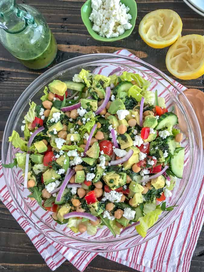 This beautiful, delicious Mediterranean Salad is an easy to throw together meal filled with crunchy cucumber, red bell peppers, onions, and chickpeas all tossed in an easy homemade vinaigrette. Sure to become a favorite #MeatlessMonday meal option! #chickpeas #salad #mediterraneansalad   https://withpeanutbutterontop.com