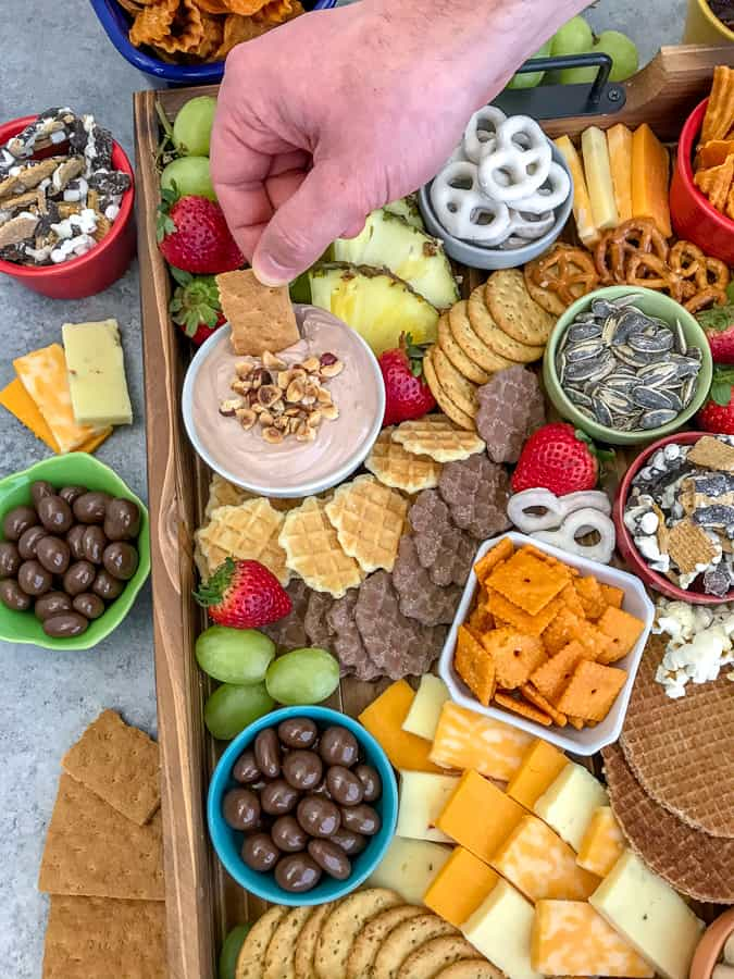 Party Grazing Snack Tray - the ultimate snack tray for any party! No cooking required, easy to throw together and full of sweet and salty snacks. Guaranteed to wow your family and friends! #partyplatter #party #partytray #partyboard #snacks #appetizers | https://withpeanutbutterontop.com