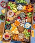 Party Grazing Snack Tray - the ultimate snack tray for any party! No cooking required, easy to throw together and full of sweet and salty snacks. Guaranteed to wow your family and friends! #partyplatter #party #partytray #partyboard #snacks #appetizers   https://withpeanutbutterontop.com
