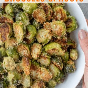 Bowl filled with Crispy Garlic Parmesan Brussels Sprouts.