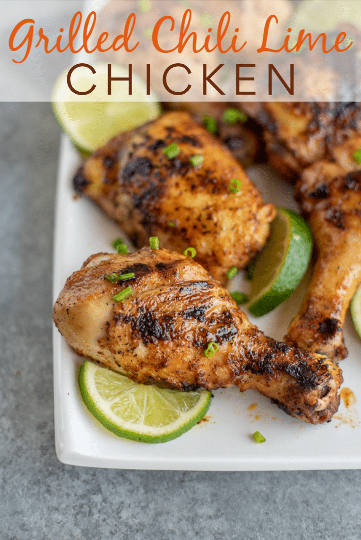 Grilled Chili Lime Chicken garnished with green onions and served with lime wedges.