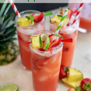 Glasses filled with Sparkling Strawberry Pineapple Limeade.