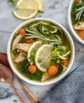 Two bowls filled with Lemon Chicken Zoodle Soup.