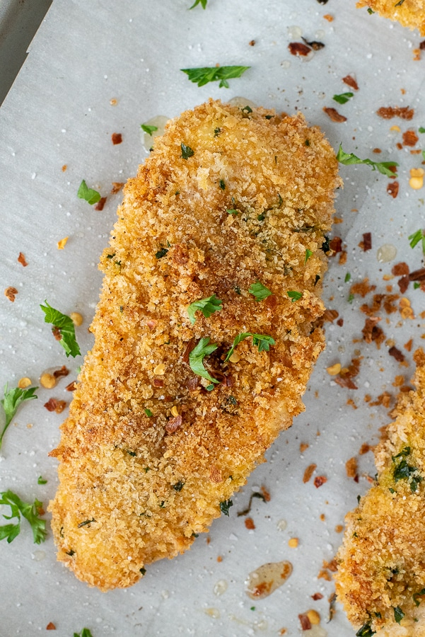 Sheet pan with panko crusted chicken cutlets.