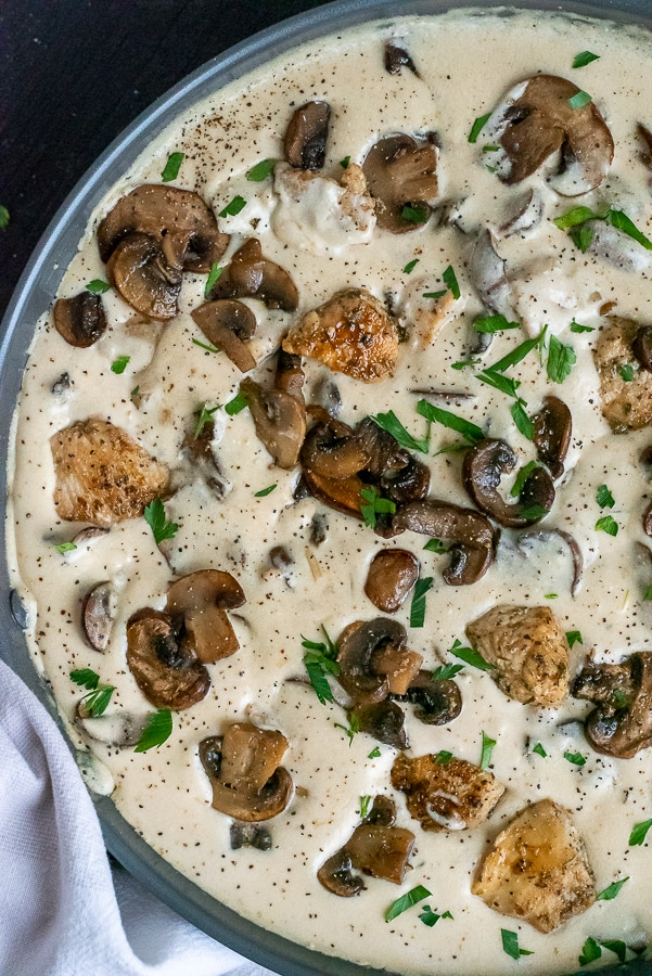 Pan of seared chicken in a creamy mushroom sauce.