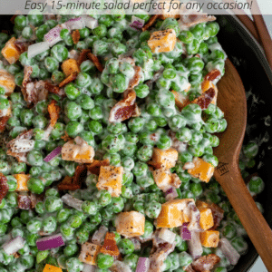 Black bowl filled with a creamy bacon pea salad.