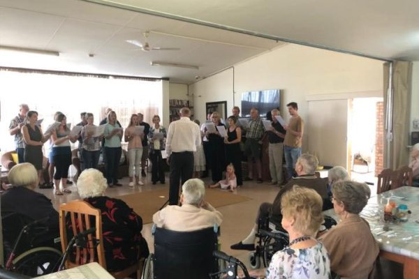 People singing in an old-age home
