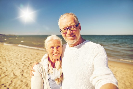 senior couple taking picture with smartphone shutterstock_445157308_web