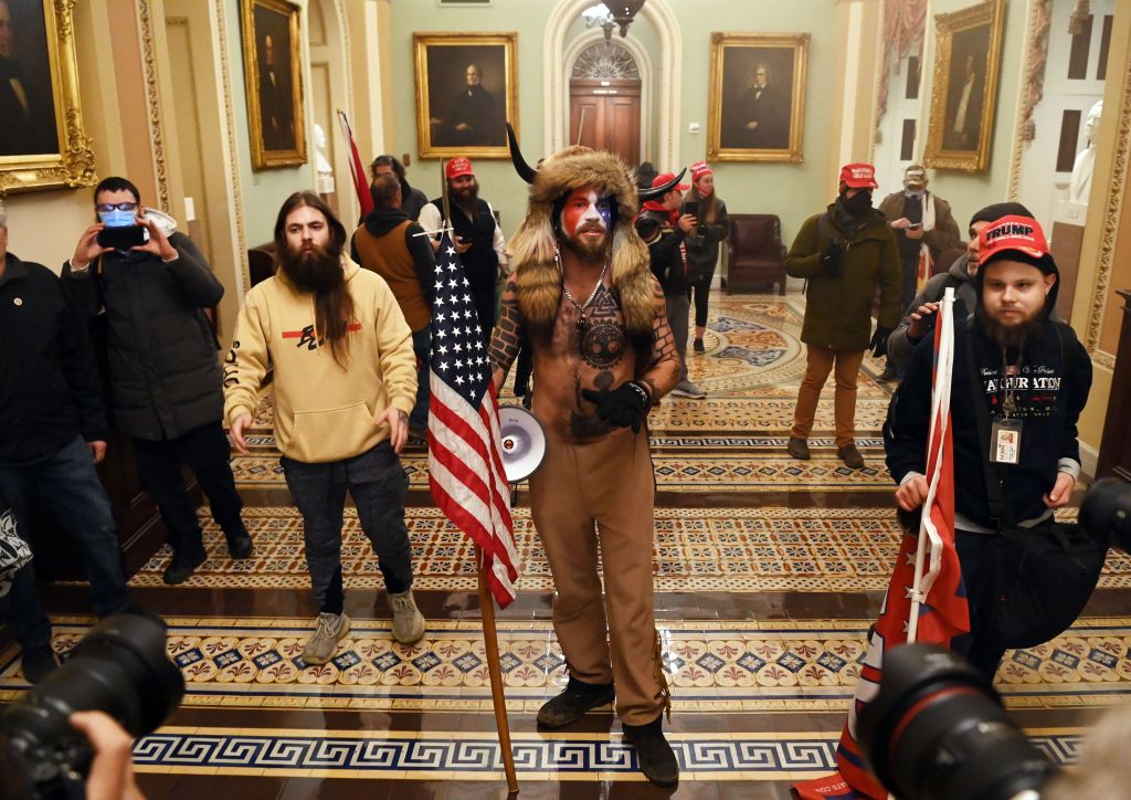 """1 Woman shot and killed as Donald Trump """"patriots,"""" protesters storm the Capitol."""
