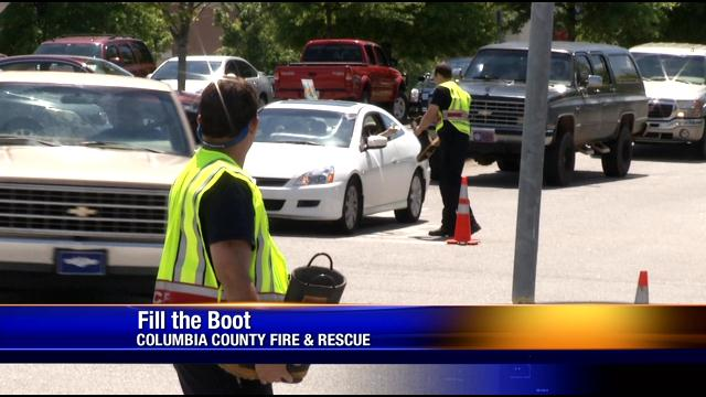 Firefighters Take Off Their Boots For A Great Cause (Image 1)_27719