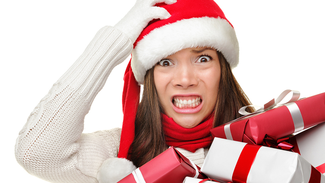 Christmas stress - busy woman wearing santa hat stressing for ch_348813