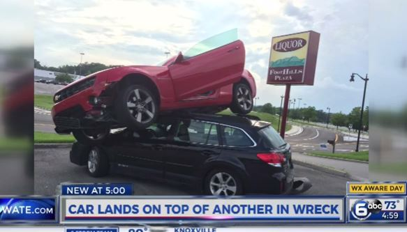 car lands on top of another in wreck_27026