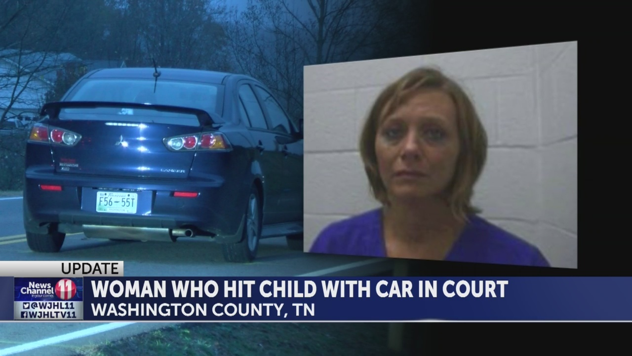 Woman accused of hitting boy with car claims she 'did not see the school bus'