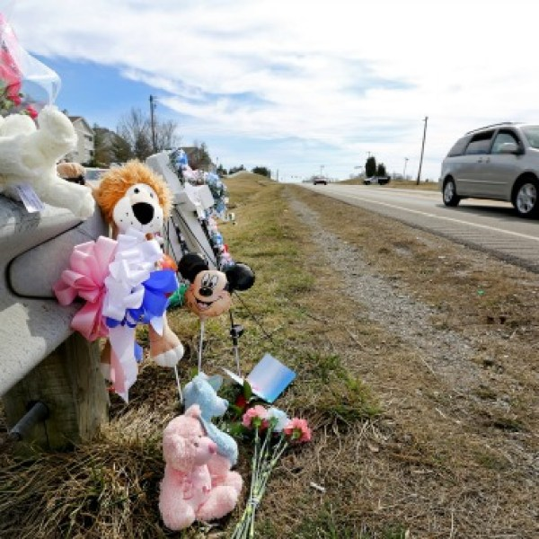 This Monday, March 16, 2015 photo shows a makeshift memorial set up on the side of the road near where Charles Napier, 49, of Florence, and his_129214