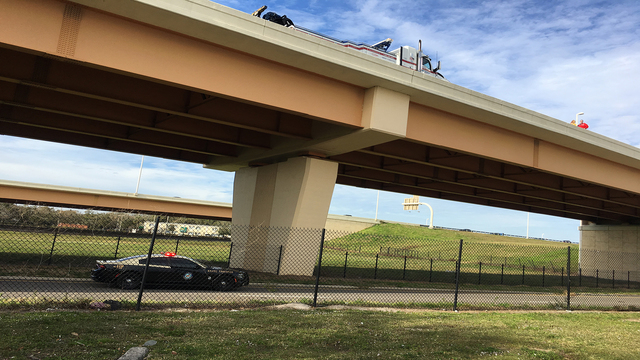 Motorcyclist thrown from overpass