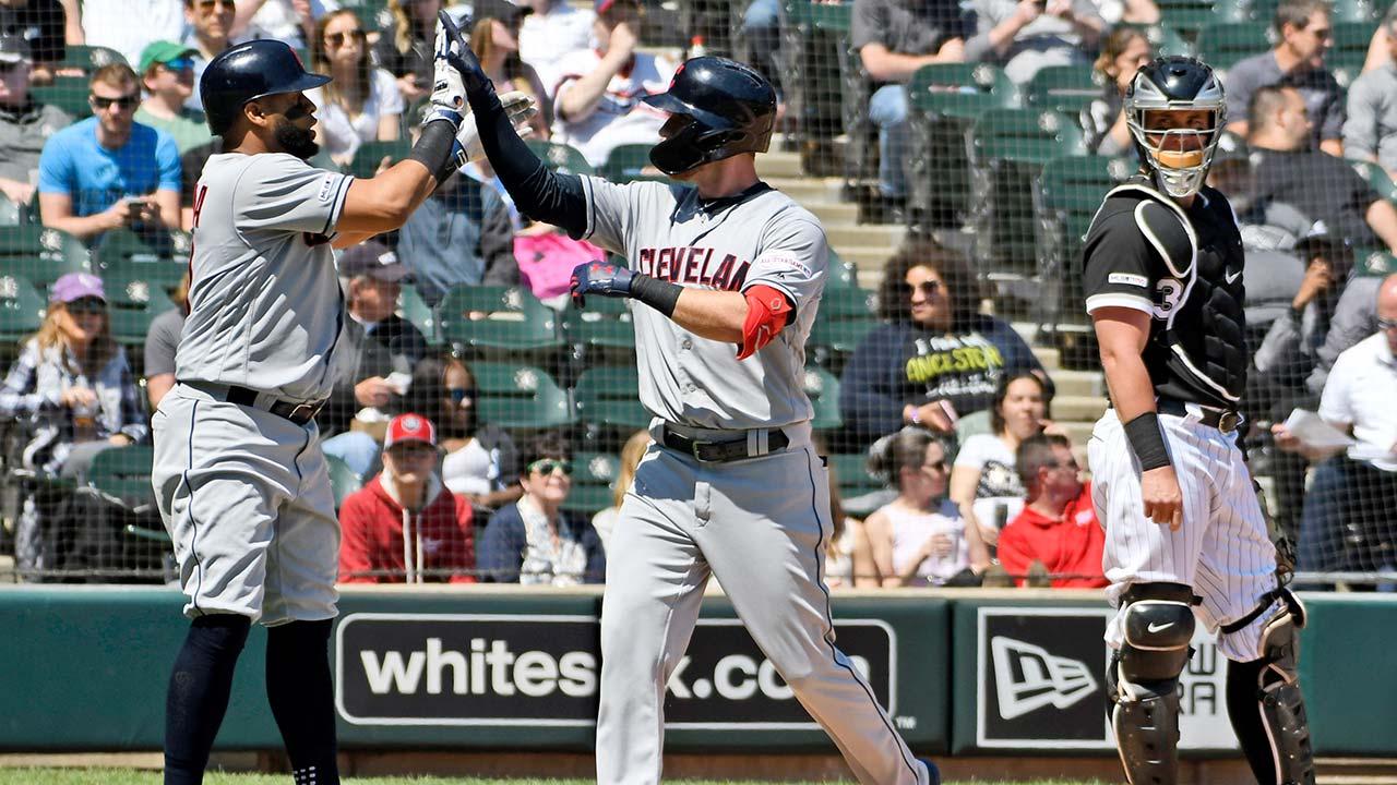Cleveland Indians' Jordan Luplow and Carlos Santana