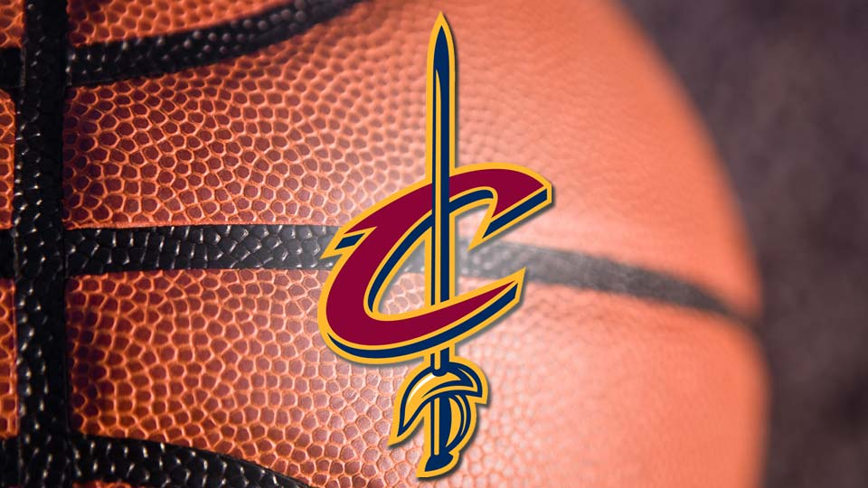 Cleveland Cavaliers logo in front of a basketball.
