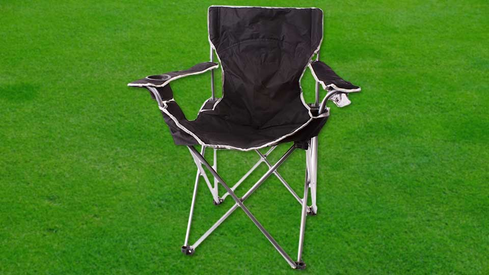 A lawn chair sitting on top of grass.