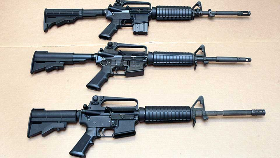 FILE - In this Aug. 15, 2012 file photo, three variations of the AR-15 rifle are displayed at the California Department of Justice in Sacramento, Calif. On Sept. 19, 2019, Connecticut-based Colt Firearms said it was suspending production of its version of the AR-15 for the civilian market.