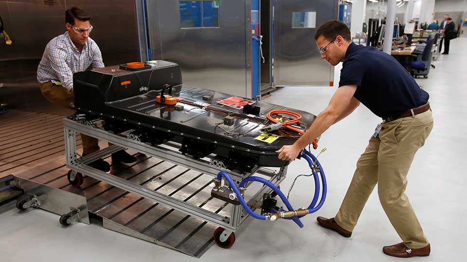 FILE- In this Nov. 4, 2016, file photo, a Chevrolet Bolt EV battery pack is removed for testing after undergoing charging and discharging cycles at General Motors Warren Technical Center's Advanced Energy Center in Warren, Mich. If U.S. consumers ever ditch fuel burners for electric vehicles, then the United Auto Workers union is in trouble. Gone would be thousands of jobs at engine and transmission plants across the industrial Midwest, replaced by smaller workforces at squeaky-clean mostly automated factories that mix up chemicals to make batteries.