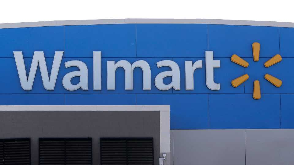 A Walmart logo is attached to the outside of a Walmart store, Tuesday, Sept. 3, 2019, in Walpole, Mass.