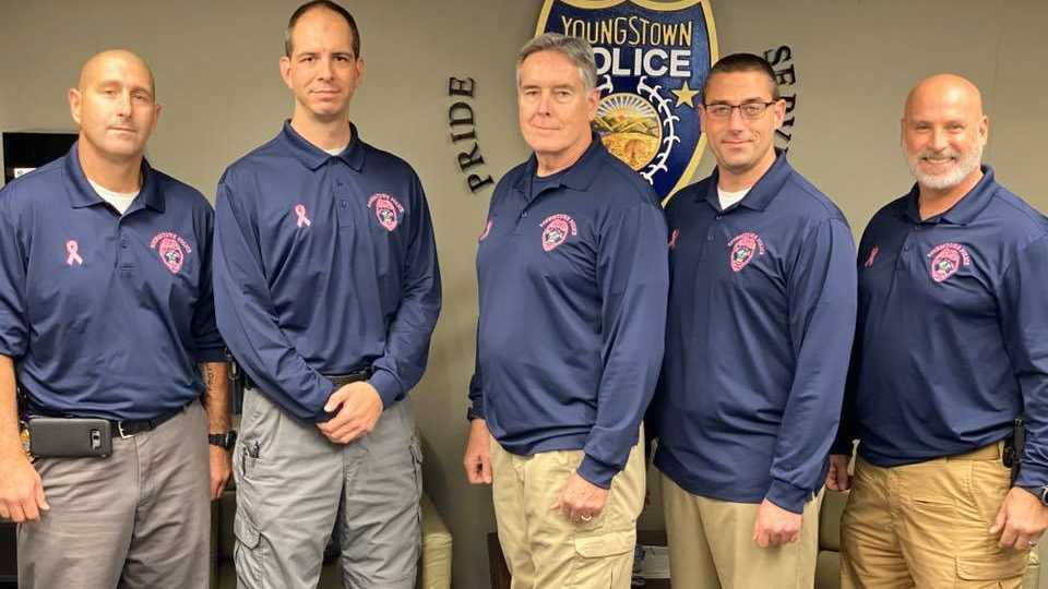 Youngstown Police Department wears pink badges