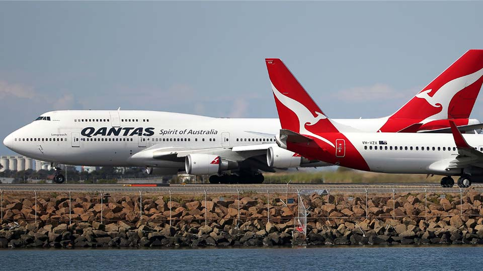 In this Aug. 20, 2015 file photo, two Qantas planes taxi on the runway at Sydney Airport in Sydney, Australia (AP Photo/Rick Rycroft).