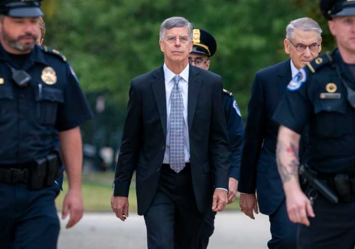 Ambassador William Taylor, is escorted by U.S. Capitol Police as he arrives to testify before House committees as part of the Democrats' impeachment investigation of President Donald Trump, at the Capitol in Washington, Tuesday, Oct. 22, 2019