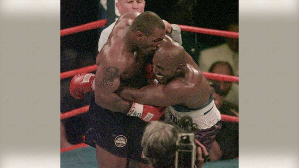 FILE - This June 28, 1997, file photo shows Mike Tyson biting into the ear of Evander Holyfield in the third round of their WBA heavyweight match in Las Vegas.