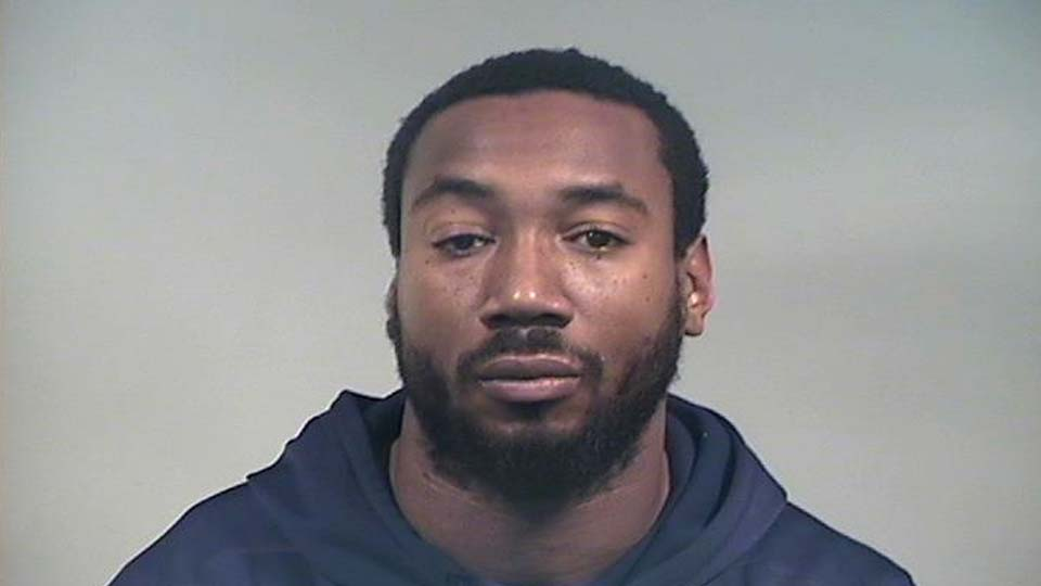Mario Manningham, charged with driving under suspension or in violation of license restriction