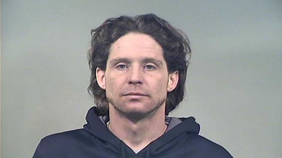Bryan Hoskin, 38, was arrested just after midnight Saturday on charges of assault on a police, assault of firefighter, attempted burglary and resisting arrest.
