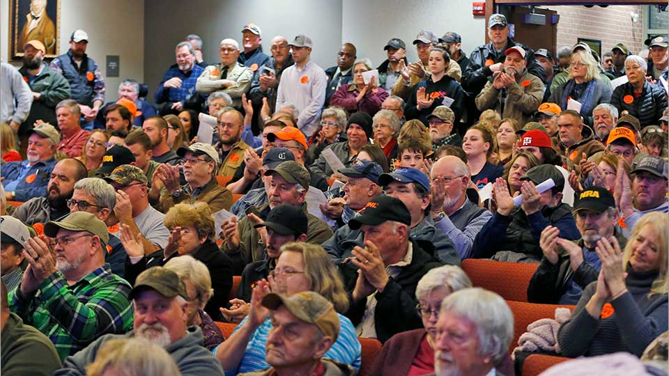 Spectators applaud as the Buckingham County Board of Supervisors unanimously voted to pass a Second Amendment Sanctuary City resolution at a meeting in Buckingham , Va., Monday, Dec. 9, 2019. The board passed the resolution without any public discussion.