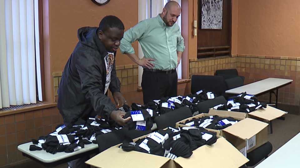 Lonny Parker, with Mighty Cubs, donates 1,000 socks to the Rescue Mission of the Mahoning Valley