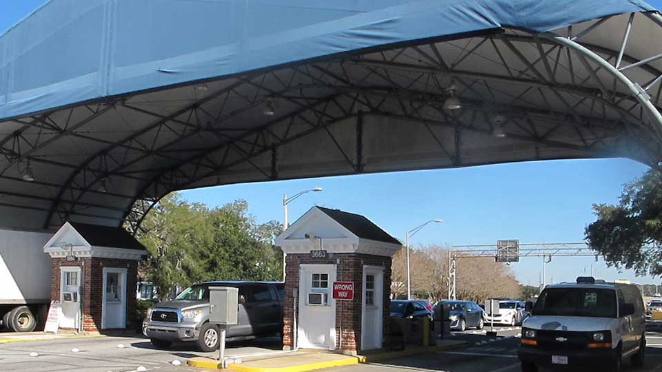 FILE- In this Jan. 29, 2016 file photo shows the entrance to the Naval Air Base Station in Pensacola, Fla. The US Navy is confirming that an active shooter and one other person are dead after gunfire at the Naval Air Station in Pensacola. Area hospital representatives tell The Associated Press that at least 11 people were hospitalized. The base remains locked down amid a huge law enforcement response. (AP Photo/Melissa Nelson, File)