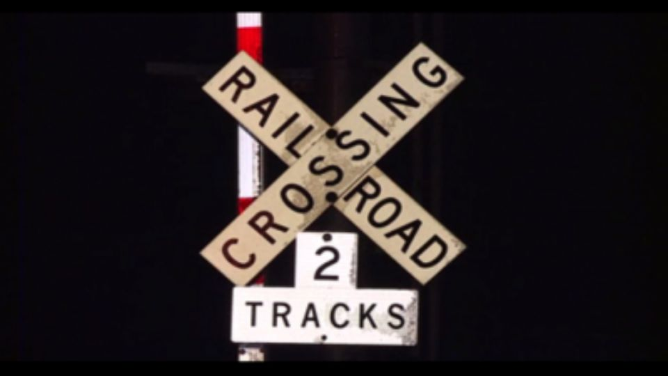 A train crashed into a car at a railroad crossing in Perry Twp.
