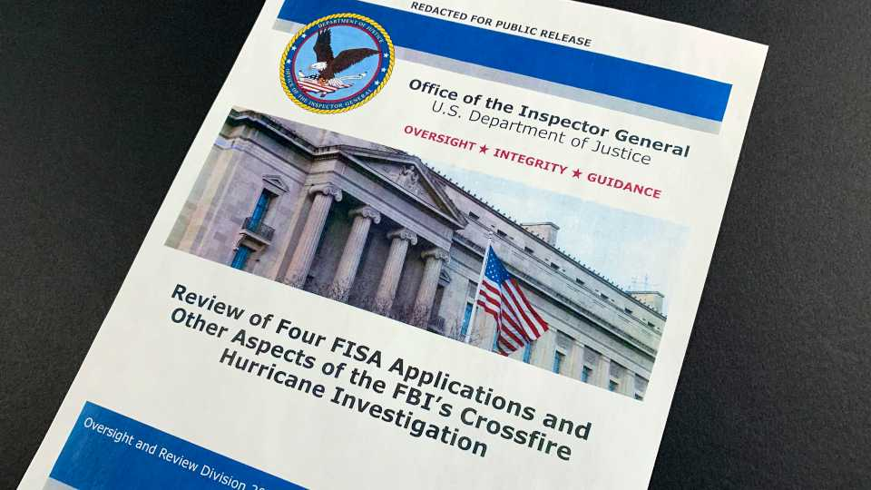 The cover page of the report issued by the Department of Justice inspector general is photographed in Washington (AP Photo/Jon Elswick)