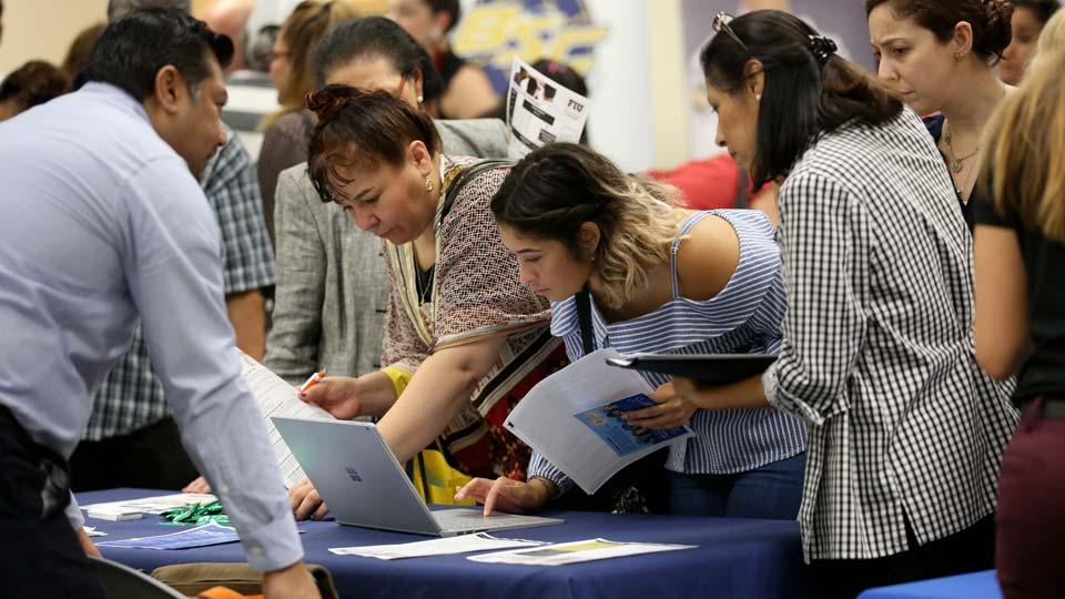 Job applicants looks at jobs available at Florida International University