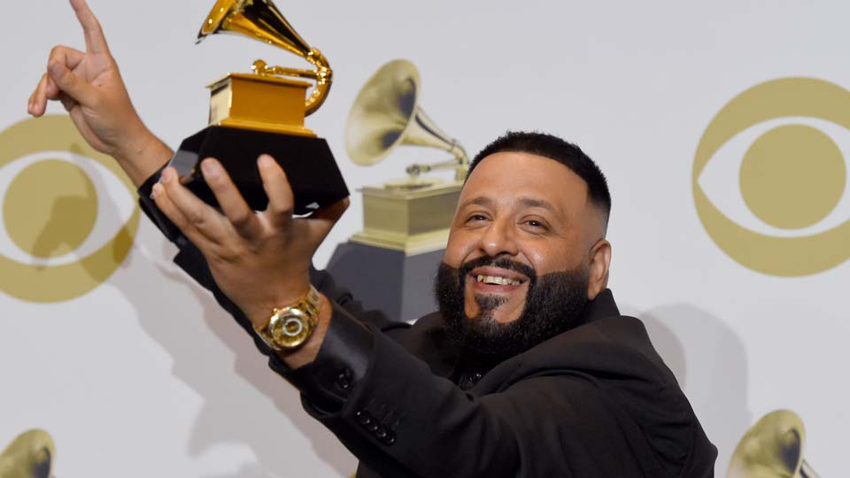 "DJ Khaled poses in the press room with the award for best rap/sung performance for ""Higher"" at the 62nd annual Grammy Awards"