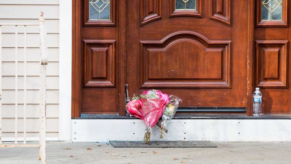 Flower bouquets rest on the doorstep of a rabbi's residence in Monsey, N.Y., Sunday, Dec. 29, 2019, following a stabbing Saturday night during a Hanukkah celebration.